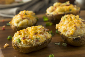 baked potatoes with cheese and chives