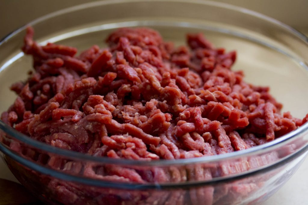 raw ground beef in a glass bowl