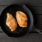 chicken breasts in a cast iron pan